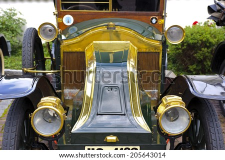 LANDSBERG, GERMANY - JULY 12, 2014: Public oldtimer rally in Bavarian city Landsberg for at least 80 years old veteran cars with a front view of Renault BZ, built at year 1910 - stock photo