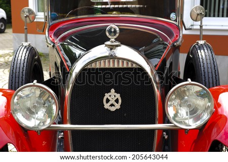 LANDSBERG, GERMANY - JULY 12, 2014: Public oldtimer rally in Bavarian city Landsberg for at least 80 years old veteran cars with a front view of Hotchkiss open Tourer, built at year 1928 - stock photo
