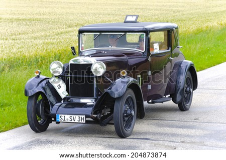 LANDSBERG, GERMANY - JULY 12, 2014: Public oldtimer rally organized by Bavarian city Landsberg for at least 80 years old veteran cars with unknown drivers in Sunbeam 16 HP, built at year 1930.
