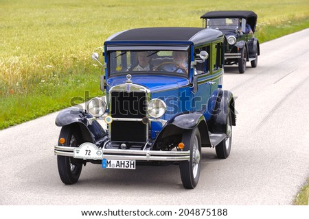LANDSBERG, GERMANY - JULY 12, 2014: Public oldtimer rally organized by Bavarian city Landsberg for at least 80 years old veteran cars with unknown drivers in Chevrolet AD Sedan, built at year 1930