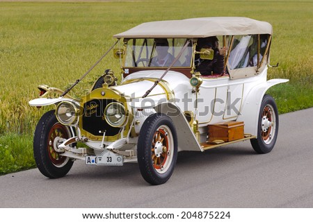 LANDSBERG, GERMANY - JULY 12, 2014: Public oldtimer rally organized by Bavarian city Landsberg for at least 80 years old veteran cars with unknown drivers in De Dion Bouton, built at year 1912 - stock photo