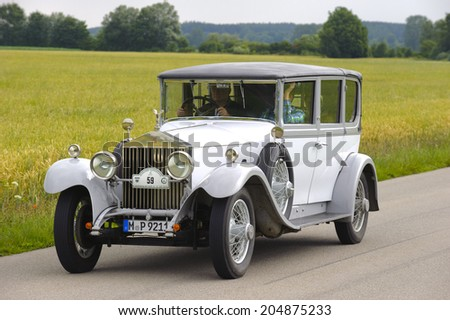 LANDSBERG, GERMANY - JULY 12, 2014: Public oldtimer rally organized by Bavarian city Landsberg for at least 80 years old veteran cars with unknown drivers in Rolls Royce Phantom I, built at year 1928