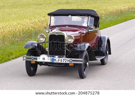 LANDSBERG, GERMANY - JULY 12, 2014: Public oldtimer rally organized by Bavarian city Landsberg for at least 80 years old veteran cars with unknown drivers in Ford A Roadster, built at year 1930 - stock photo