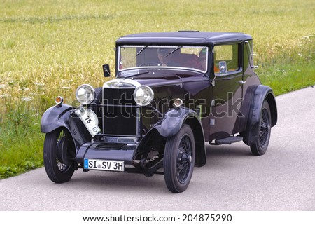 LANDSBERG, GERMANY - JULY 12, 2014: Public oldtimer rally organized by Bavarian city Landsberg for at least 80 years old veteran cars with unknown drivers in Sunbeam 16 HP, built at year 1930