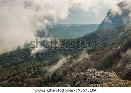 Landscape above and below  clouds on Mount Ai Petri in  Crimea in Russia