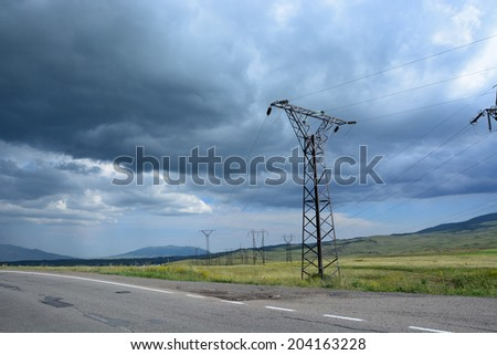 Landscape along roadside with transmission towers - stock photo