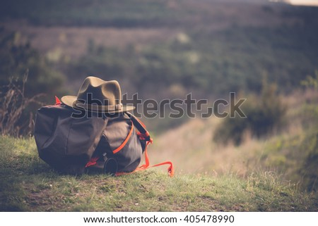 Landscape and big backpack with hat - stock photo