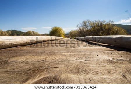 Landscape and wood bridge over creek in Yellowstone National Park. - stock photo