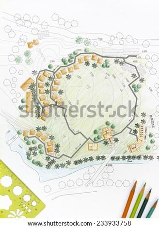 Landscape architect designing on site analysis plan. - stock photo