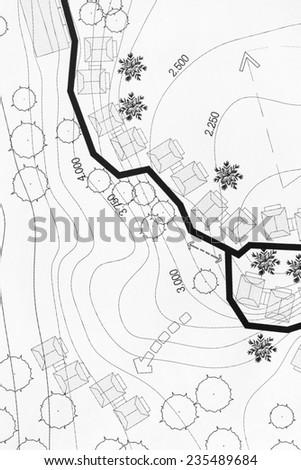Landscape Architect Designing on site analysis plan for resort. - stock photo