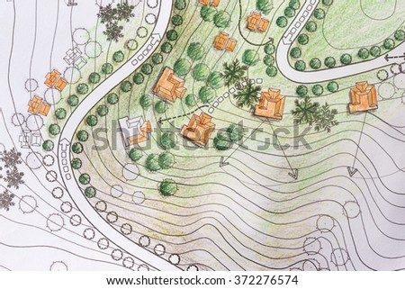 Landscape Architect Designing on site analysis plan of resort on hill. - stock photo