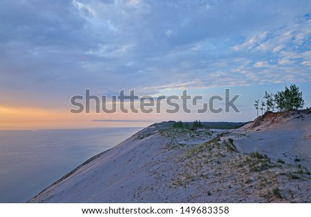 Landscape at twilight of sand dune and waters of Lake Michigan, Sleeping Bear Dunes National Lakeshore, Michigan, USA  - stock photo