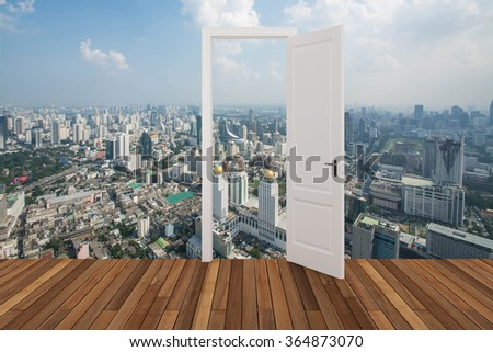Landscape behind the opening door - stock photo