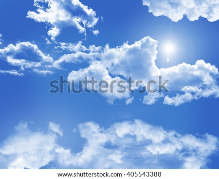 Landscape. Blue sky with clouds and sun.