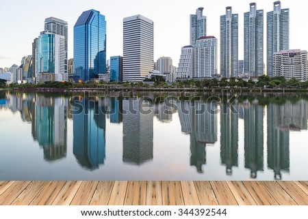 Landscape building modern business district of bangkok at dawn sky, beautiful water reflection. - stock photo