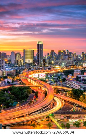 Landscape building modern business district of Bangkok Expressway in the foreground at sunset, Stunning sky. - stock photo