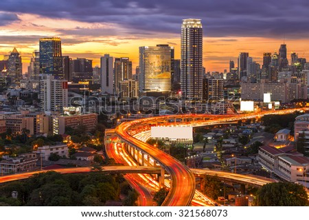Landscape building modern business district of Bangkok. S-shaped expressway in the foreground at twilight.