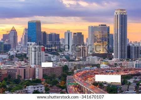 Landscape building modern business district of Bangkok with the expressway in the foreground at sunset or sunrise.