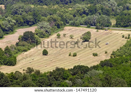 Landscape from above with straw bales and agricultural area - stock photo