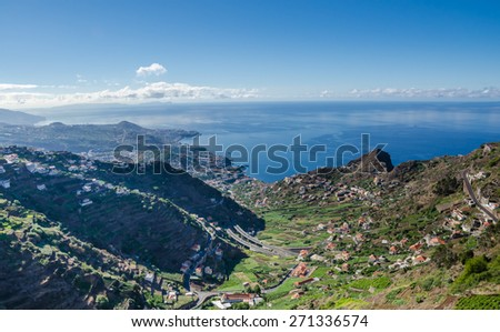 Landscape from the mountains to the village Camara de Lobos and Funchal. Southern coast of  island Madeira, Portugal. - stock photo