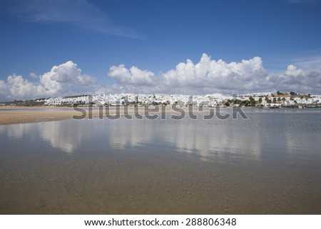 landscape from water of white houses Conil de la Frontera village Andalusia Spain Europe