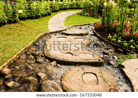 Landscape garden design. The path in the garden with pond in asian style - stock photo