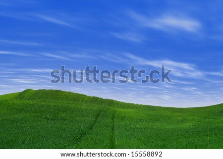 Landscape - green hills over blue sky with white clouds