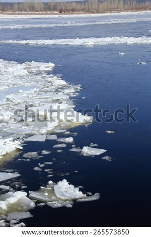 landscape ice drift on the river in the spring on a sunny day - stock photo