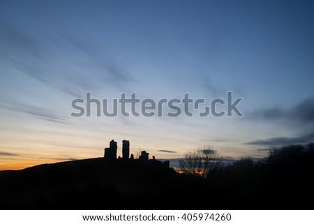 Landscape image of enchanting fairytale castle ruins during beautiful sunset - stock photo