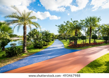 Landscape in city park with colorful sidewalk , Getaway for urbanites