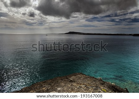 Landscape in los Ajaches,in the horizon, the island of Fuerteventura. Canary islands, Lanzarote, Spain  - stock photo