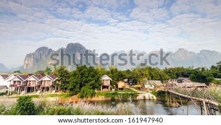 Landscape in morning at Vang Vieng, Laos near many guest house. - stock photo