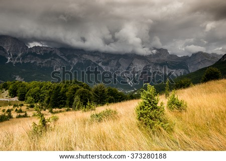 landscape in the mountains, high mountains and heavy dark clouds. - stock photo