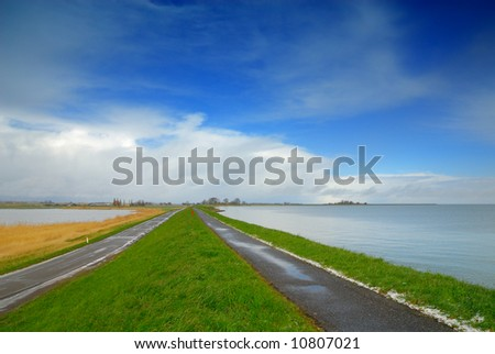 """landscape in the netherlands (lake called the """"ijsselmeer"""" to the right) - stock photo"""