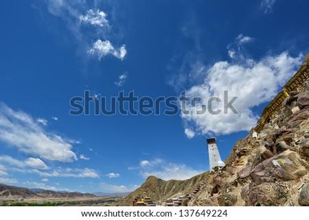 Landscape in Tibet with blue sky ( holy mountain near Tashilunpo monastery worshipped by Buddhist pilgrims ) - stock photo