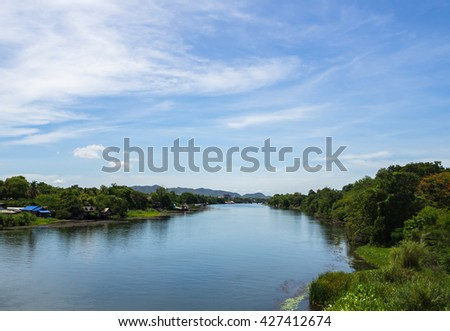 Landscape, large river with trees and blue sky good view