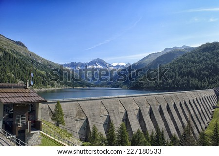 Landscape mountains Lake Dam in Front View in Italy Trentino Dolomites Alps