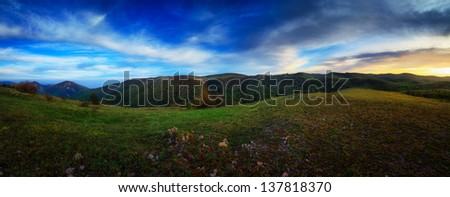 Landscape. Mountains under the blue sky with clouds at sunset