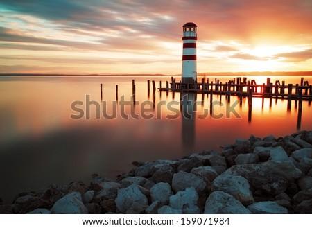 Landscape ocean sunset - lighthouse - stock photo