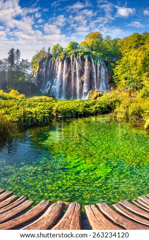 Landscape of a beautiful rock with a waterfall under the blue sky. Plitvice Lakes National Park is the oldest national park in Southeast Europe and the largest national park in Croatia. - stock photo