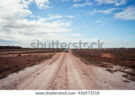 Landscape of a dirt road in outback Queensland, Australia. - stock photo