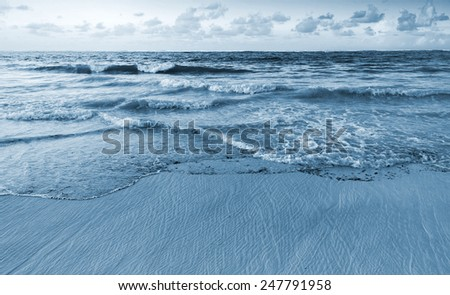 Landscape of Atlantic ocean coast. Dominican republic, Punta Cana. Blue toned photo filter effect - stock photo