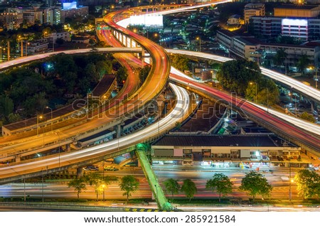 Landscape of Bangkok expressway in the foreground at twilight. - stock photo