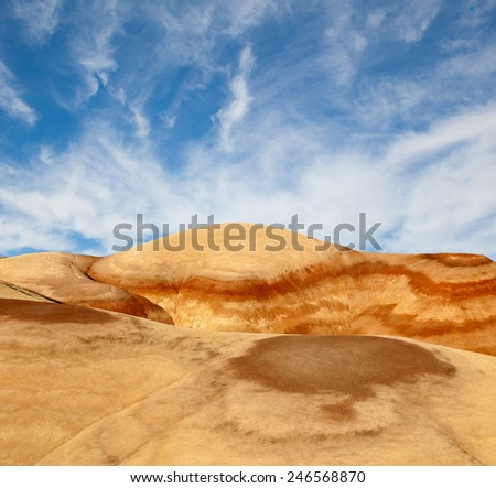 Landscape of beautiful desert nature in Utah, Southwest USA, colorful hills of petrified sand and blue sky with clouds - stock photo