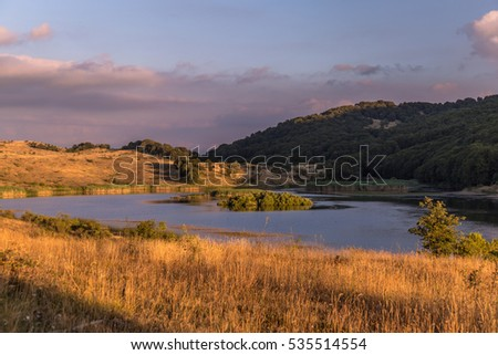 Landscape of Biviere lake with views of Etna, Nebrodi mountains, Messina, Sicily