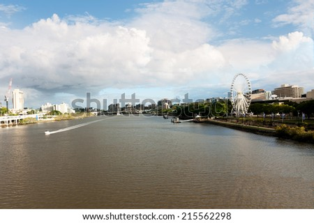 Landscape of Brisbane River with the Wheel of Brisbane on the background - stock photo