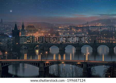 Landscape of Charles Bridge in Prague at dusk with glowing stars - stock photo