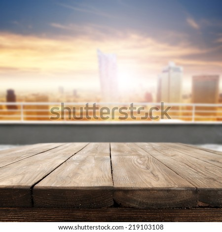 landscape of city and board of brown dark wooden table