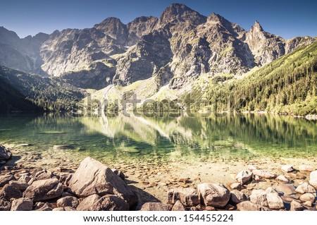 Landscape of clear mountain lake. Morskie Oko, Tatry. - stock photo
