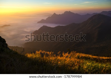 Landscape of cloud and fog mountain in twilight scene from Thailand.